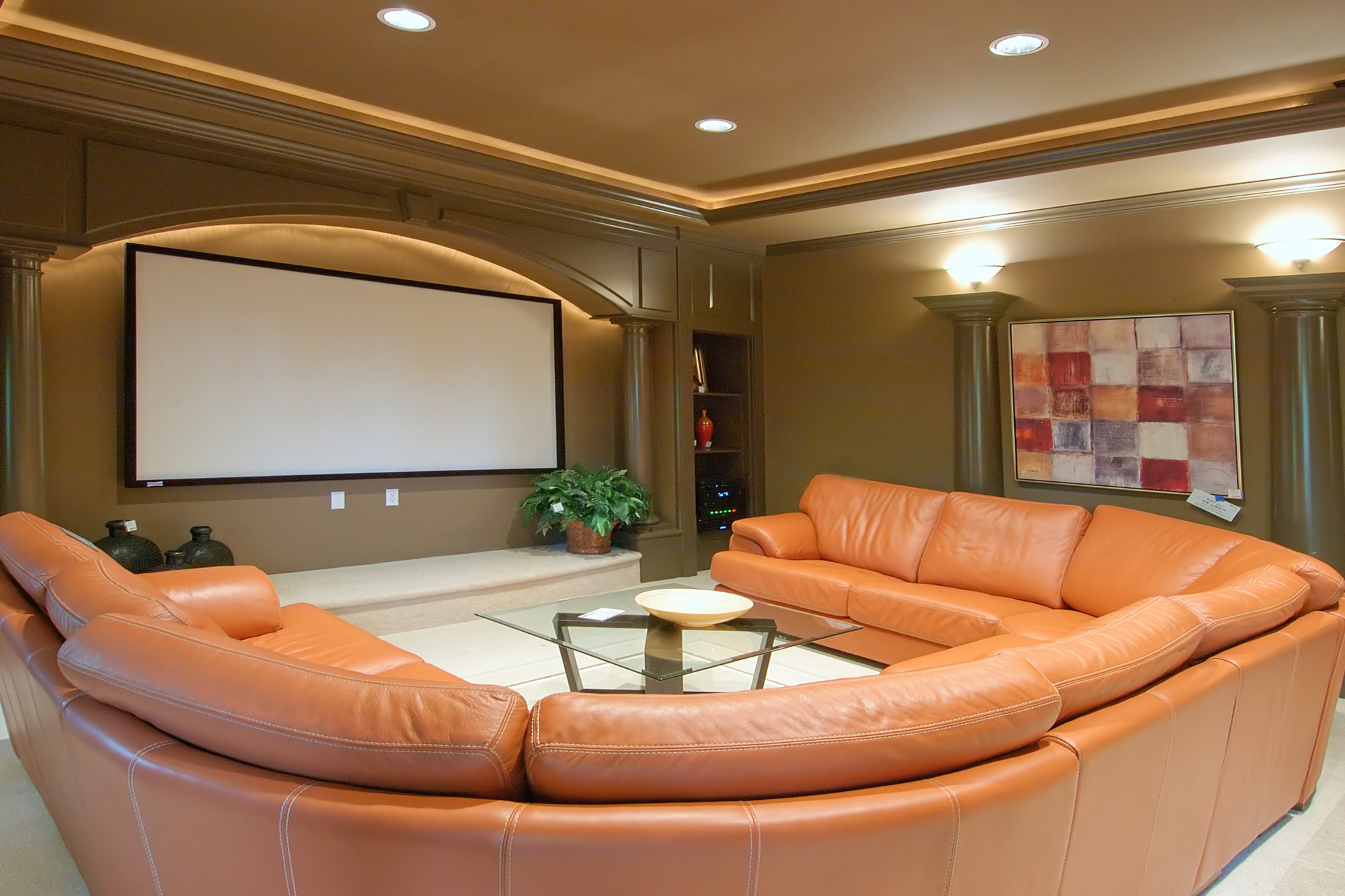 home theater room with wrap around couch